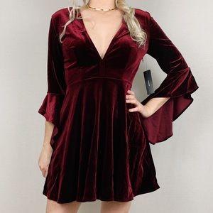 Wrapped in Luxe Burgundy Velvet Bell Sleeve Dress
